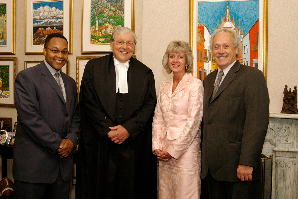 Photo of Ann Buller with Judge Michael Tulloch (left), the Hon. Roy McMurtry and former Centennial College President Richard Johnston, 2004.