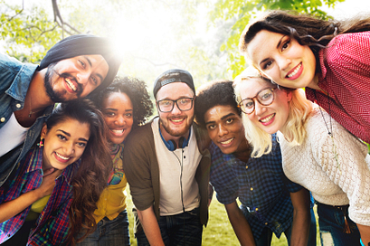 A group of diverse college students smiling outdoors