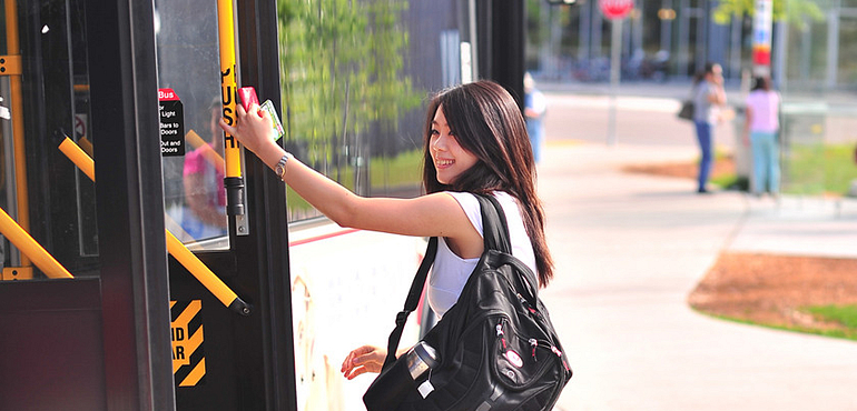 Female student getting off TTC bus at Progress Campus - Centennial College