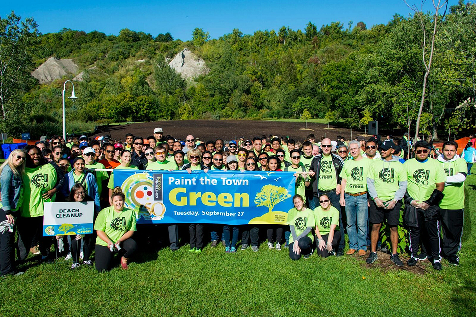 Photo of Ann Buller with volunteers at the Paint the Town Green clean-up event, Bluffer's Park, 2016.