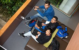 Picture of Centennial College students on a balcony in the Progress Campus Library