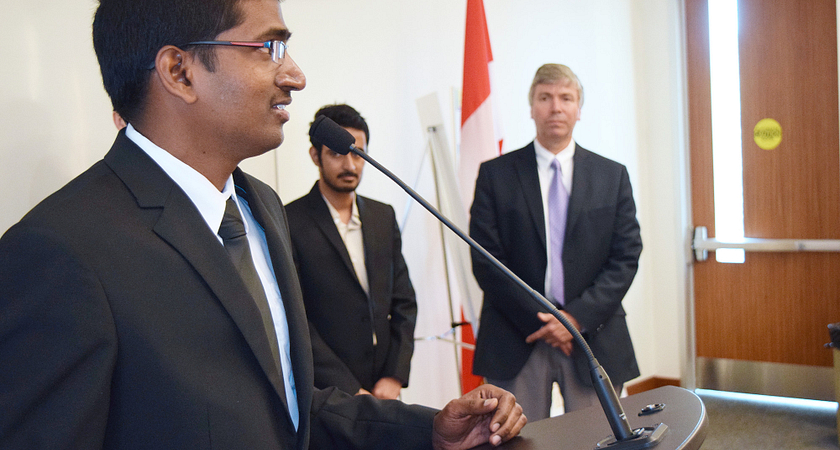 Picture of a Centennial College student giving a speech after winning an award at the 2015 E3 Symposium