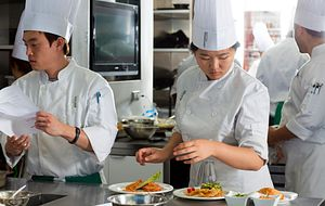 Picture of two centennial college students in chef training working in a kitchen