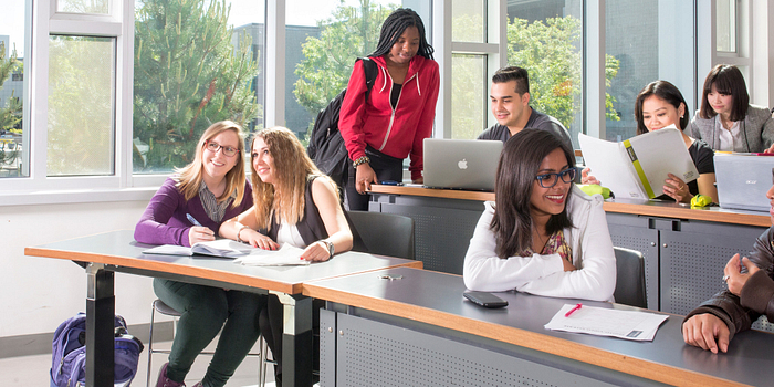 picture of Centennial College students participating in a focus group in a classroom