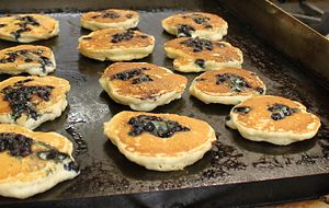 picture of blueberry pancakes cooking on stove
