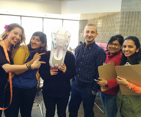 A group of Centennial College students posing with the Centennial Chase Mascot Shoesie