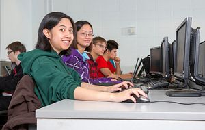 Picture of Centennial College students in a computer lab smiling