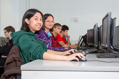 Students in a computer lab working on desktop computers