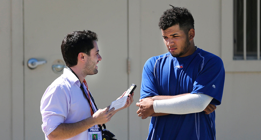 picture of a Centennial College Sports Journalism program student interviewing a Toronto Blue Jays baseball player