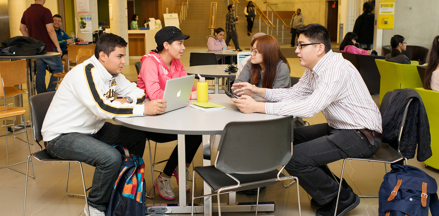 picture of Centennial College International Education students working together at a table in the library