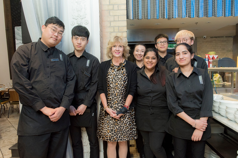 Photo of Ann Buller with volunteer culinary students at a CENTItalia event in downtown Toronto, 2017.