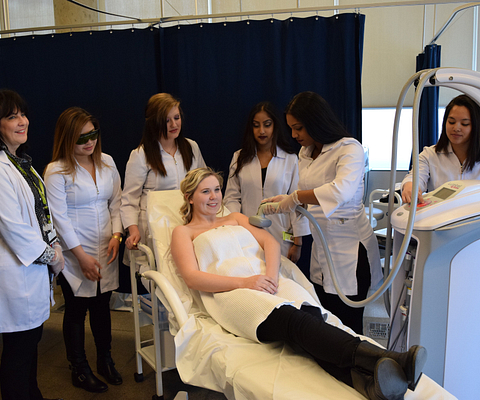 Picture of Centennial College Esthetics students practicing on a student volunteer