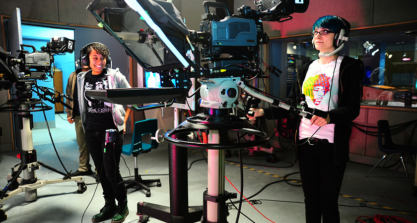 picture of centennial college students in the broadcasting and film studio operating cameras