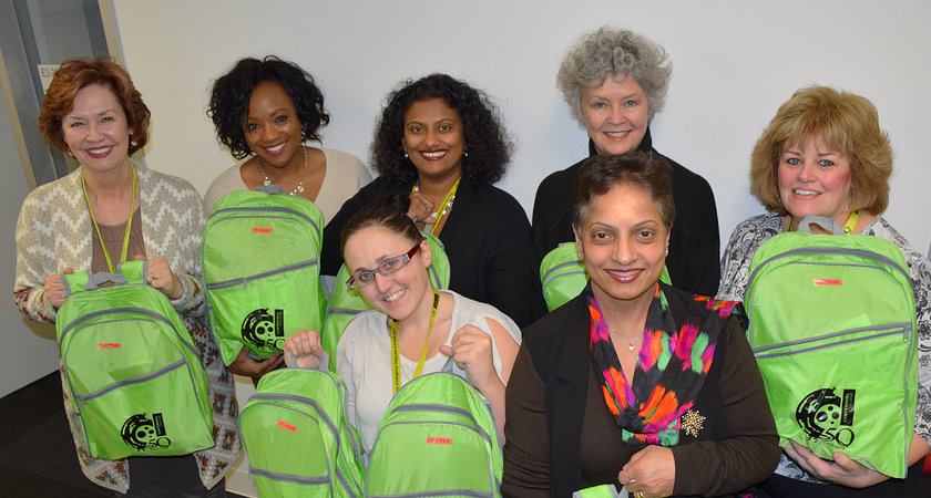 picture of the School of Advancement team holding backpacks to be donated to Syrian refugee children
