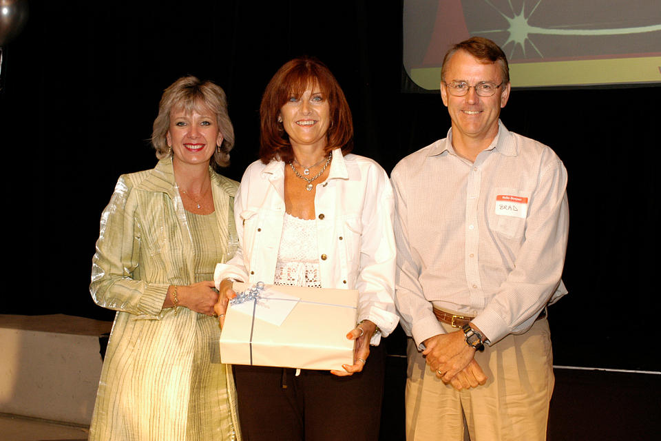 Photo of Ann Buller with professor Christine Gauthier and CFO Brad Chapman at Centennial Day, 2004.