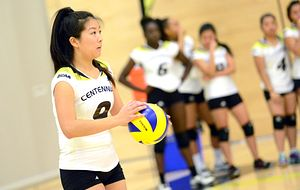 picture of a Centennial College volleyball team member serving a ball during a game