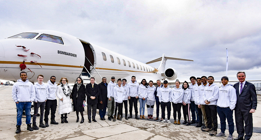 Bombardier Plane with a group of students