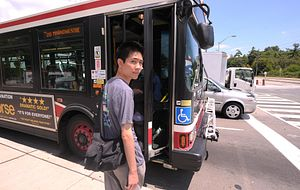 picture of a Centennial College student boarding a TTC bus