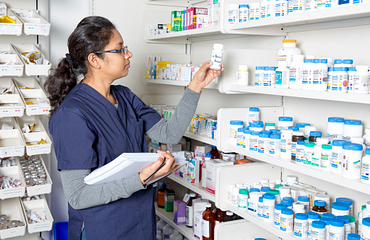 Female student practises inventory in the pharmacy lab