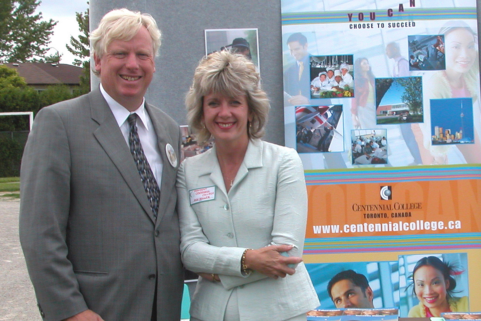 Photo of Ann Buller with Toronto Mayor David Miller at the Malvern Project launch, 2004.