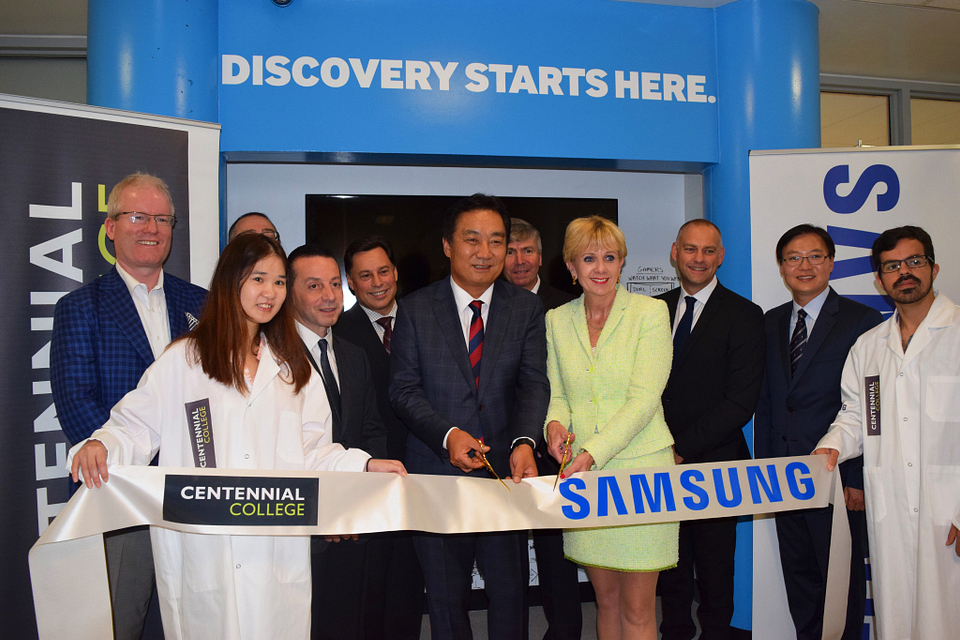 Photo of Ann Buller cutting the ribbon to the new Samsung Tech Institute at Progress Campus, 2015.