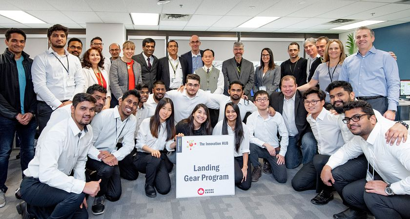 picture of a group of Centennial employees at the official opening of the Innovation Hub