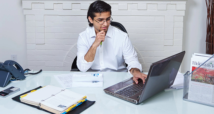Male student taking online summer courses from home